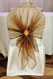 chair bows. chair covers like the idea, something different than just a sash and bow. bows