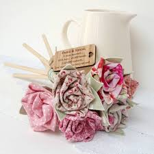 wood anniversary flowers in metal jug with oak
