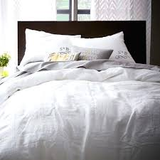 white bed linen with black trim white bed