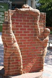 make a sculpture on a brick wall