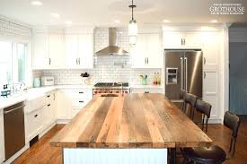 farmhouse kitchen with a reclaimed chestnut designed by coastal cabinet works island countertops overhang