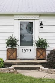 Get all the details of this charming front porch makeover featuring DIY  wood planters and a