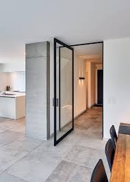 Modern Glass Pivoting Door With A Black Aluminium Frame Custom - Exterior pivot door