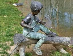 garden statue of boy fishing at gibbs garden mar