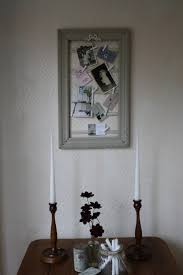 upcycled vintage peg frame in stone grey with white ribbon crest and mini pegs vinterior