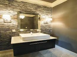 double downlight wall sconces applied on mosaic tile wall on both sides of framed mirror for bathroom wall sconce ideas