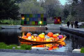float boat sits in the native plant garden koda study 1 and koda study 2 are seen in the background chihuly s koda series displays the use of movement