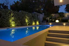 landscape lighting around swimming pool for contemporary exterior color schemes