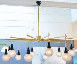 twelve murano glass globe shades and black glass cones extend from brass branches on this italian