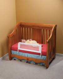 wooden frame toddler bed with rails