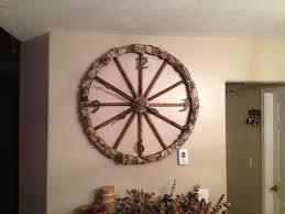 antique wagon wheel clock by shoat roath custom wagon wheel chandelier by terry hertz in wagon