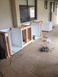 shelf cabinets and timber frame in between an plan on having a wooden bench top was thinking maybe tile round the bbq or use stainless steel plates