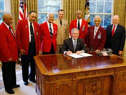 president george w bush is joined by members of the tuskegee president george w bush is joined by members of the tuskegee airmen joint chiefs chairman admiral michael mullen center background and department of