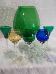 6 glass pieces 5 feet tinted glasses a large glass with decorative ball