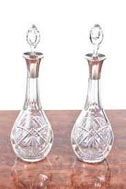 pair of antique clear cut glass decanters
