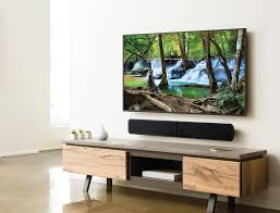 sound bar mounted below a tv