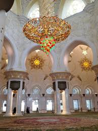 one of the world s largest chandeliers hangs in the main prayer hall 10 metres in diameter and 15 metres high gilded with 24 carat gold and adorned with