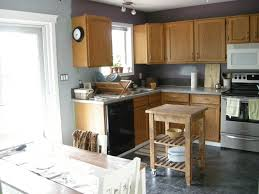 grey wall paint with brown wooden oak cabinet and white countertop intended for kitchen paint colors