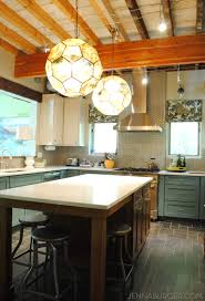 Big Glass Vintage Rounded Hanging Pendant Lights Eclectic Kitchen Design  White Porcelain Island Countertop Wood Beam Ceiling Black Ceramic Floors  Lighting ...