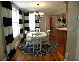 round rug under dining room table love this look round dining table cowhide rug