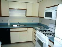 can you refinish laminate kitchen cabinets painting how to diy paint formica kitchen cabinets