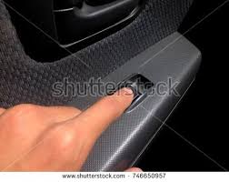 car door lock button. Control Panel Of Auto Button At Glass Door Car, Human Hand Used To  The Car Lock