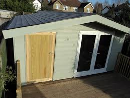 upvc white double glazed doors and window to hobby room section and pressure treated timber doors to the shed section