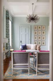 country living room ci allure: this colorful victorian sitting room mixes eclectic accents like the custom lou blass chandelier and fresh colors like mint and fuchsia to bring the owners