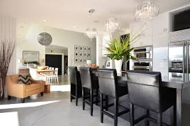 black woven pendant light above rectangular dining table for kitchen combo with modern cabinet and glass pendant lamps