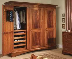organizing all sorts of apparels in one place in an armoire wardrobe