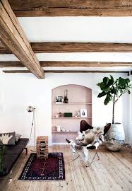 Loooove this mix- the exposed beams, accent built-in, butterfly chair and  dark leather - Interior Decor