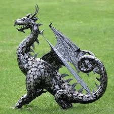 large metal dragon statue w open wings