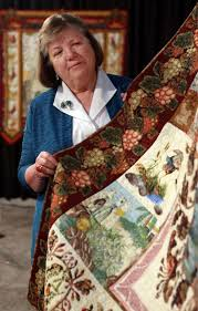 Nothing old-fashioned about these quilts - Houston Chronicle & Cynthia Collier, of League City, stands next to her quilt, 'Audubon in Adamdwight.com