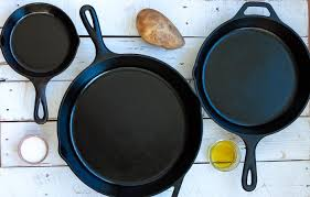 a potato salt and olive oil with three cast iron skillets that have been