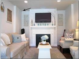 tv above fireplace where to put components hide cable box and electronics and use an remote