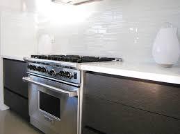 clear glass tile backsplash Kitchen Midcentury with backsplash glass