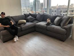 grey couch looks green
