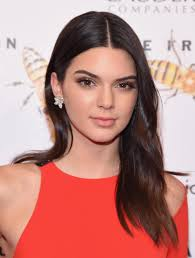 kendall jenner s new estee lauder ad is incredibly stylish from her gorgeous accessories to her perfect red suit