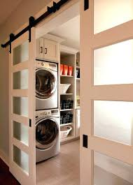 laundry room doors washer dryer laundry room traditional with barn door hardware beige black hardware built in shelves home design