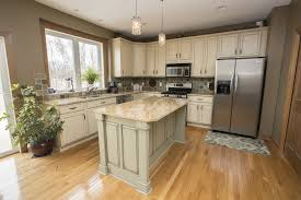 This Kitchen Features Dirty Cream Colored Cabinetry Paired With A