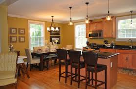 Recessed Lighting Over Dining Room Table Some Pendant Lamp In White Ceiling Also Wooden Laminating Flooring
