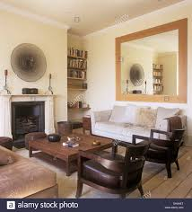 Leather Chairs Living Room Large Mirror Above Sofa In Townhouse Living Room With Wooden