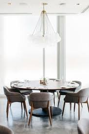 mid century style dining with a contemporary touch round table upholstered chairs and