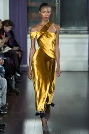Lupita Nyong o stuns in gold dress with thigh length split Daily.
