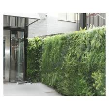 plant wall made with realistic artificial plants in the uk green  on green wall fake plants with uk artificial plant wall manufacturers installers and exporters