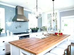 white cabinets with butcher block kitchen island wood countertops light cabine