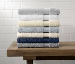 cotton hand towels for bathroom. colors top to bottom: pewter, white, ivory, shore, natural, navy cotton hand towels for bathroom
