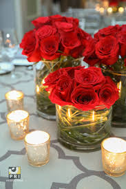 Classic red rose centerpieces and Antique Silver Votive candles are a  simple yet beautiful combo for
