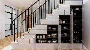 under stairs storage idea built in cupboards painted in farrow ball ammonite