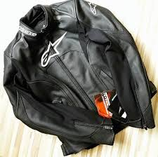 a photograph of a cool leather jacket from alpinestars that has ce rated armor and